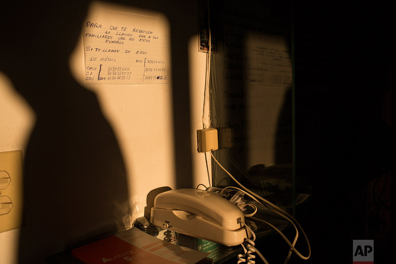 """A phone used by migrants to call their families sits in the """"Casa del Migrante"""" migrant shelter in Matamoros, Tamaulipas, Mexico, Wednesday, March 22, 2017. (AP Photo/Rodrigo Abd)"""