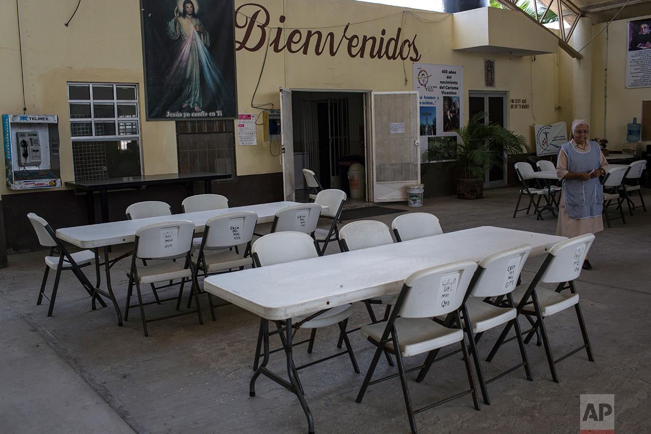 "A nun walks through the empty dining area at the migrant shelter ""La Casa del Migrante"" in Reynosa, Mexico, Wednesday, March 22, 2017. (AP Photo/Rodrigo Abd)"