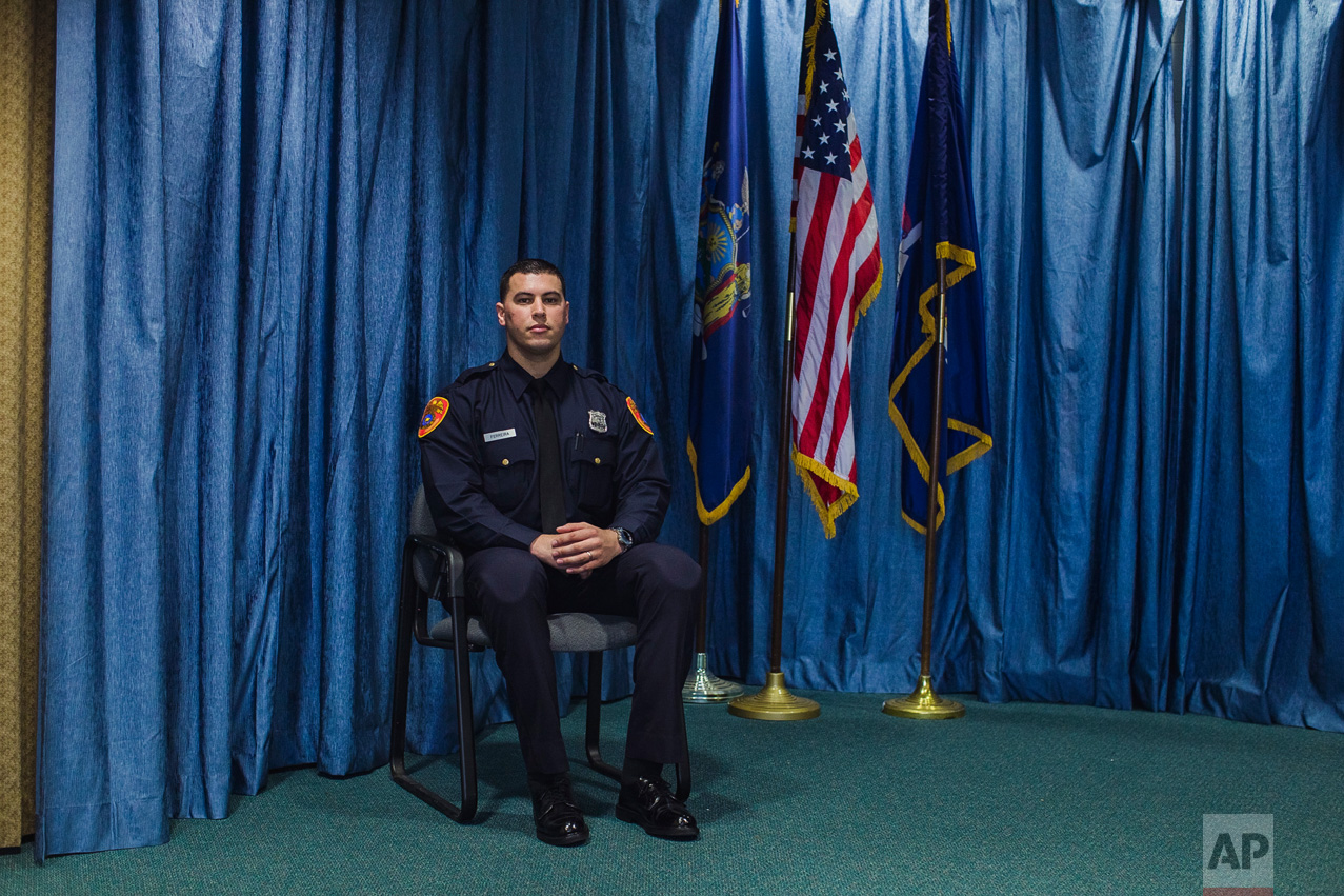 Matias Ferreira poses for a picture during his graduation from the Suffolk County Police Department Academy at the Health, Sports and Education Center in Suffolk, Long Island, New York, Friday, March 24, 2017. Ferreira, a former U.S. Marine Corps lance corporal who lost his legs below the knee when he stepped on a hidden explosive in Afghanistan in 2011, is joining a suburban New York police department. The 28-year-old graduated Friday from the Suffolk County Police Academy on Long Island following 29 weeks of training. (AP Photo/Andres Kudacki)