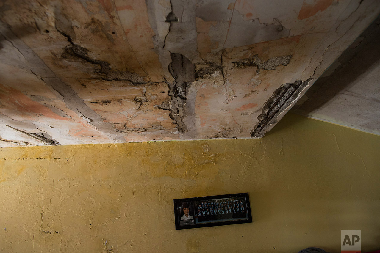 The ceiling of Jesus Esteban Cruz's dinning room in Reynosa, Mexico, Wednesday, March 22, 2017, across the border from McAllen, Texas. (AP Photo/Rodrigo Abd)