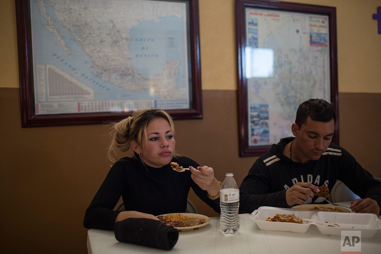 "Cuban migrants Chaday Sanchez and her boyfriend Rodolfo Munoz eat dinner at the migrant shelter ""Casa del Migrante"" in Nuevo Laredo, Tamaulipas state, Mexico, Saturday, March 25, 2017, across the border from Laredo, Texas. (AP Photo/Rodrigo Abd)"
