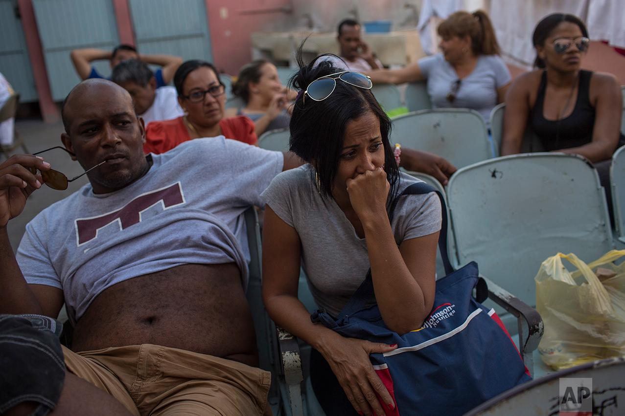 """Cubans sit in the migrant shelter """"Casa del Migrante"""" in Nuevo Laredo, Tamaulipas state, Mexico, Saturday, March 25, 2017, across the border from Laredo, Texas. (AP Photo/Rodrigo Abd)"""