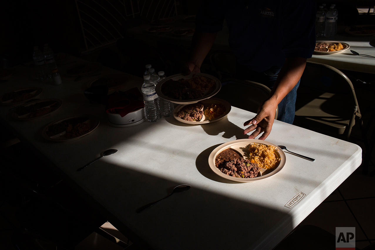 "Migrants have a dinner of rice and beans at the migrant shelter ""Casa del Migrante"" in Nuevo Laredo, Tamaulipas state, Mexico, Saturday, March 25, 2017, across the border from Laredo, Texas. (AP Photo/Rodrigo Abd)"