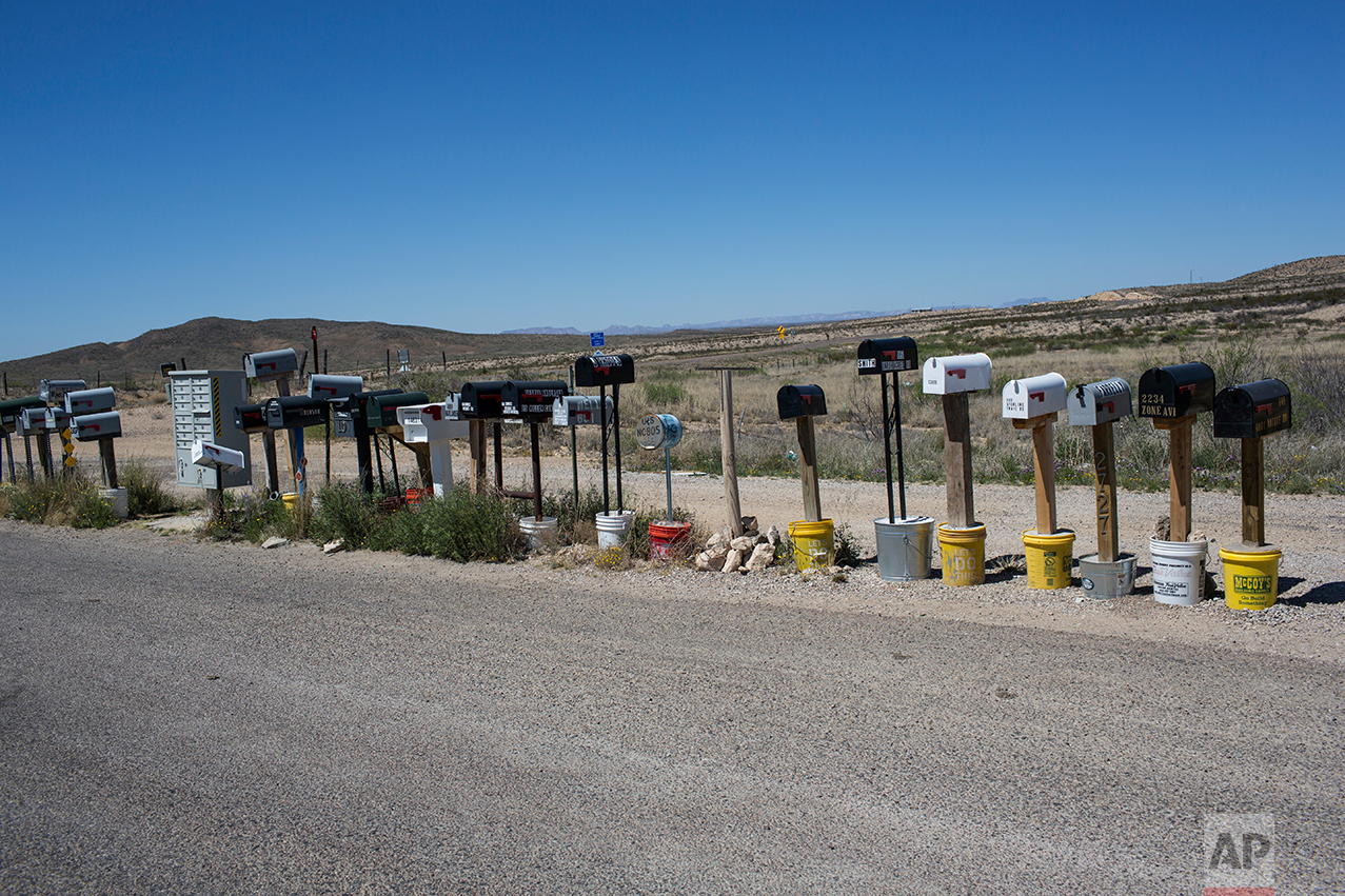 Mail boxes stand in a line in Terlingua, Texas, near the US-Mexico border, Monday, March 27, 2017. (AP Photo/Rodrigo Abd)