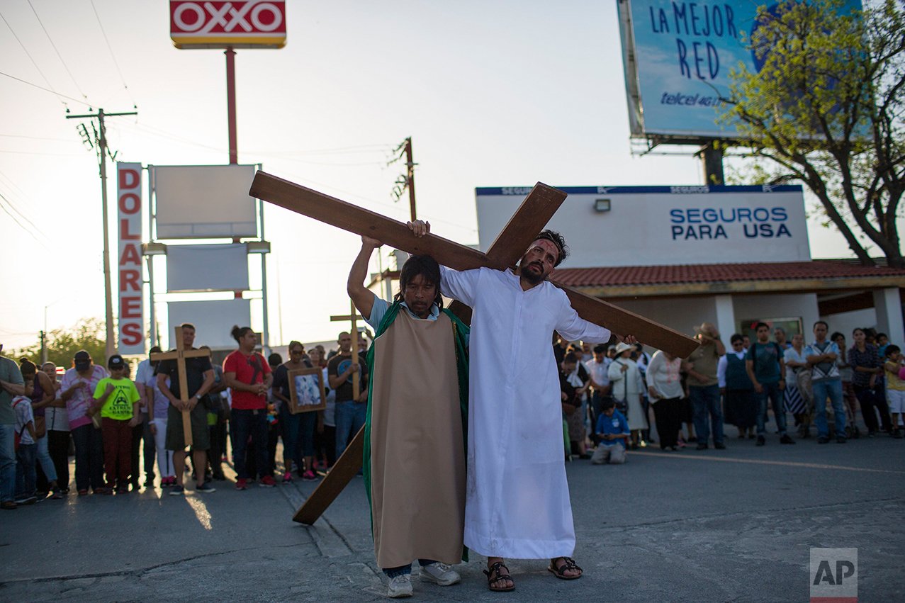 Cuban migrant Rudy Rivero leads a religious procession, adapted to reflect the plight of immigrants, in Nuevo Laredo, Tamaulipas state, Mexico, Friday March, 24, 2017, across the border from Laredo, Texas. (AP Photo/Rodrigo Abd)