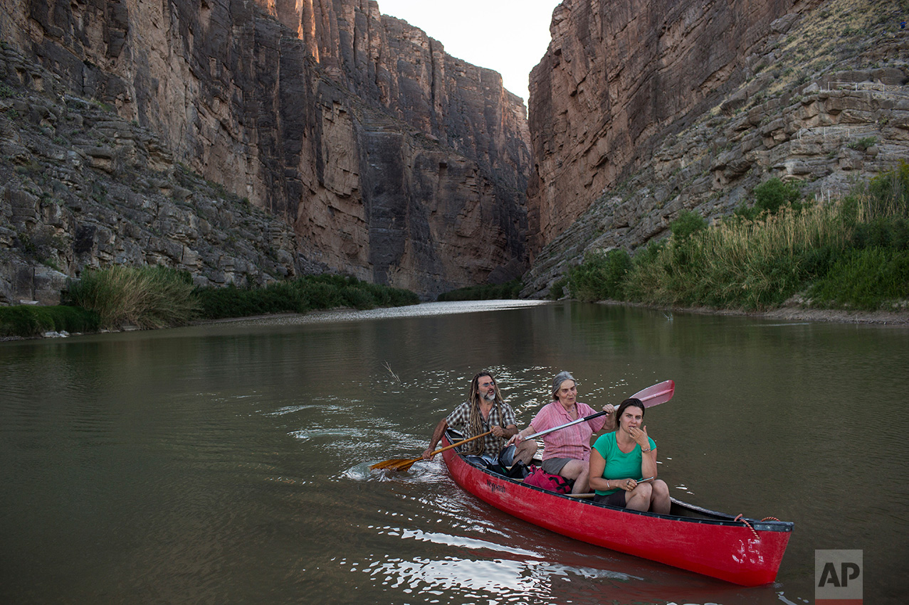 Tourists kayak through Santa Elena Canyon on the Rio Grande river, just feet from a cliff face that is Mexico, left, at Big Bend National Park in Texas, Monday, March 27, 2017. (AP Photo/Rodrigo Abd)