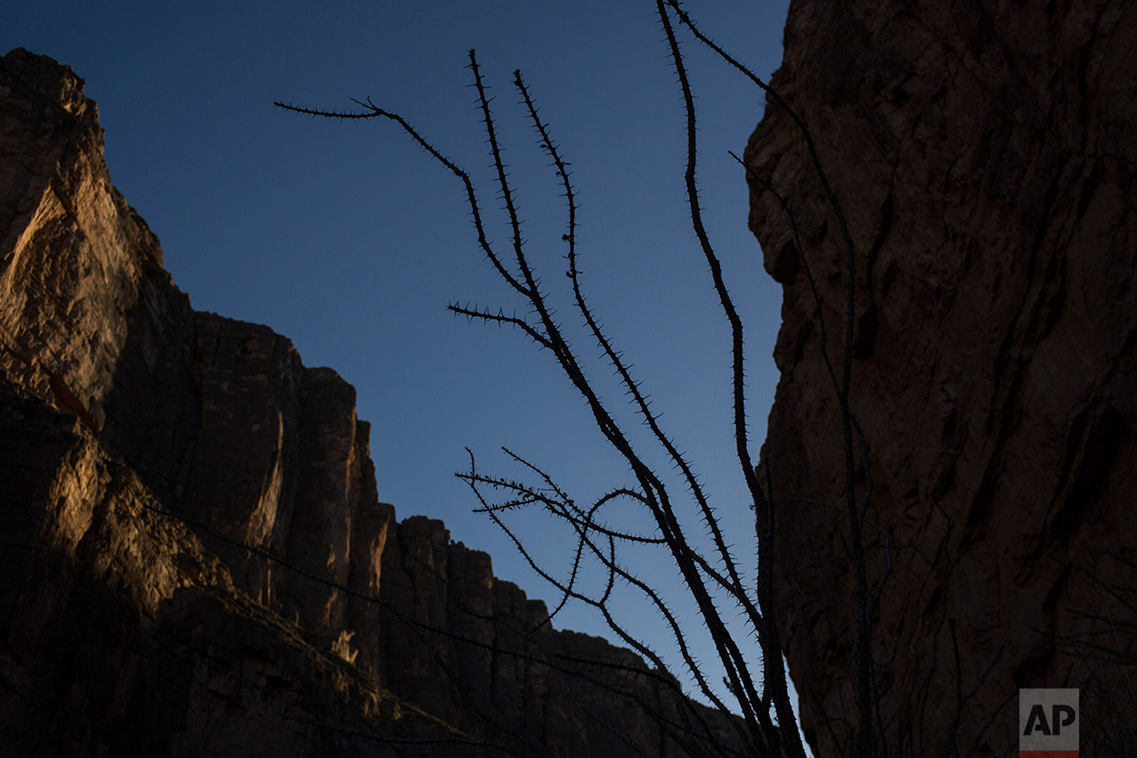 Santa Elena Canyon divides Texas and Mexico, where the Rio Grande river runs alongside Big Bend National Park in Texas, Monday, March 27, 2017. (AP Photo/Rodrigo Abd)