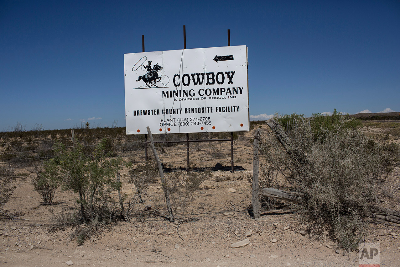 A sign advertising a mining company stands along the highway in Terlingua, Texas, about 20 miles from the US-Mexico border, Tuesday, March 28, 2017. (AP Photo/Rodrigo Abd)