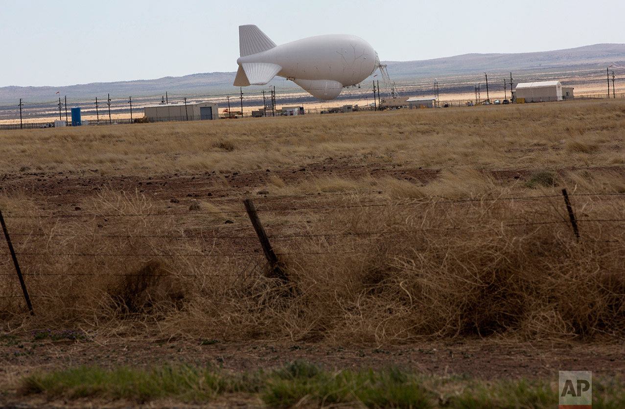 An aerostat used for surveillance by the US Border Patrol stands stationary along the highway near Valentine, Texas, about 20 miles from the US-Mexico border, Tuesday, March 28, 2017. (AP Photo/Rodrigo Abd)