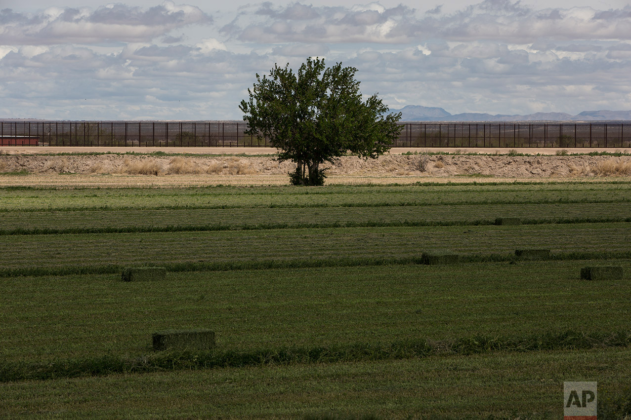 A farm located adjacent to the fence at the US-Mexico border in the Juarez valley, Mexico, Wednesday, March 29, 2017, across from the outskirts of El Paso, Texas. (AP Photo/Rodrigo Abd)