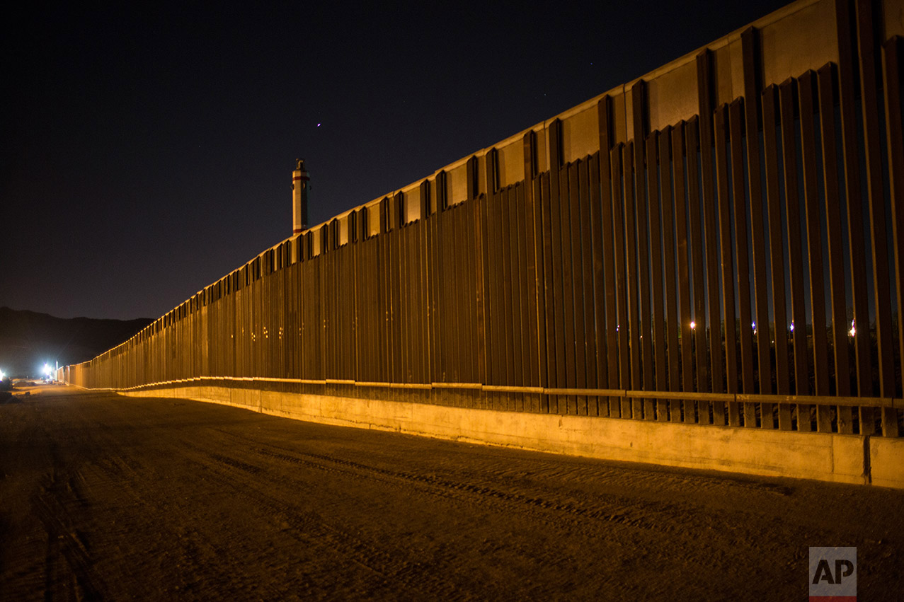 A portion of the new steel border fence stretches along the US-Mexico border in Sunland Park, New Mexico, Thursday, March 30, 2017. This fencing just west of the New Mexico state line was planned and started before President Donald Trump's election, adding to the 650 miles of fences, walls and vehicle barriers that already exist along the nearly 2,000-mile frontier. (AP Photo/Rodrigo Abd)
