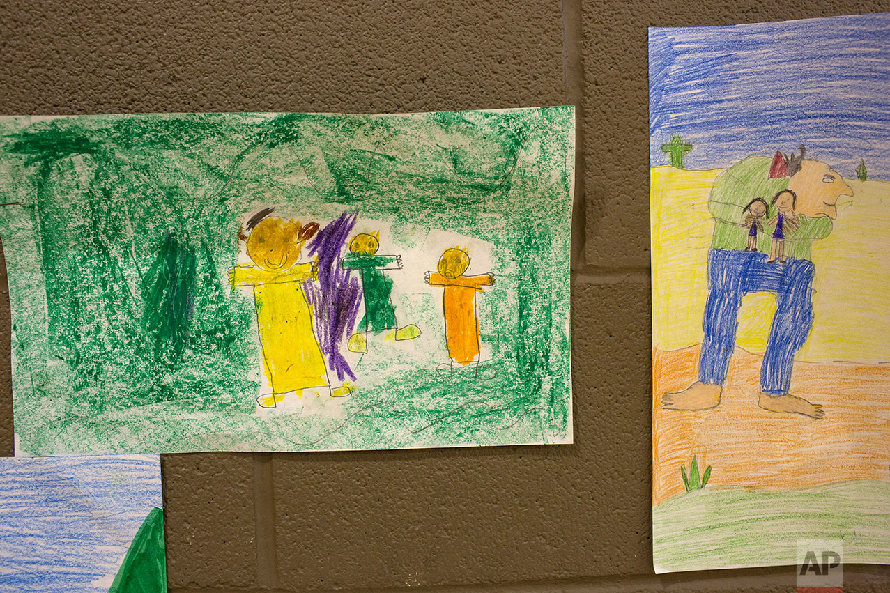 """Students interpretive drawings of """"The Gum-Chewing Rattler"""" by Joe Hayes are displayed in the gym at Columbus Elementary School, in Columbus, New Mexico, Friday, March 31, 2017. (AP Photo/Rodrigo Abd)"""
