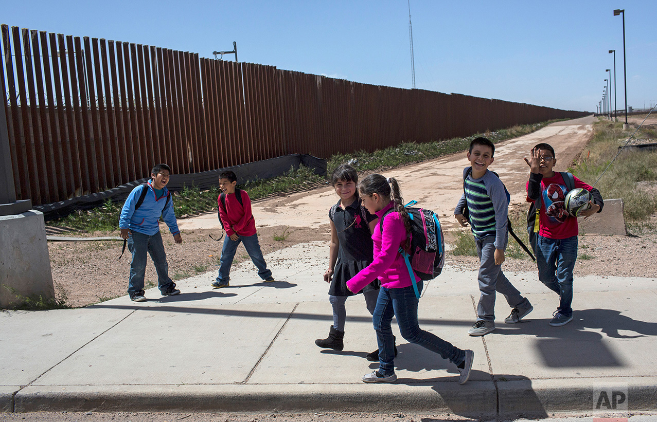 Columbus Elementary School students walk towards the U.S. port of entry on the border with Puerto Palomas, Mexico, after attending school in Columbus, New Mexico, Friday, March 31, 2017. (AP Photo/Rodrigo Abd)
