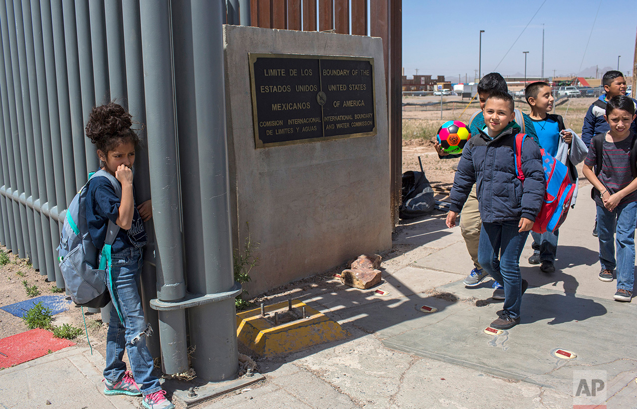 Students cross the border from Columbus, New Mexico, into Palomas, Mexico, after day of attending classes at Columbus Elementary, Friday, March 31, 2017. (AP Photo/Rodrigo Abd)