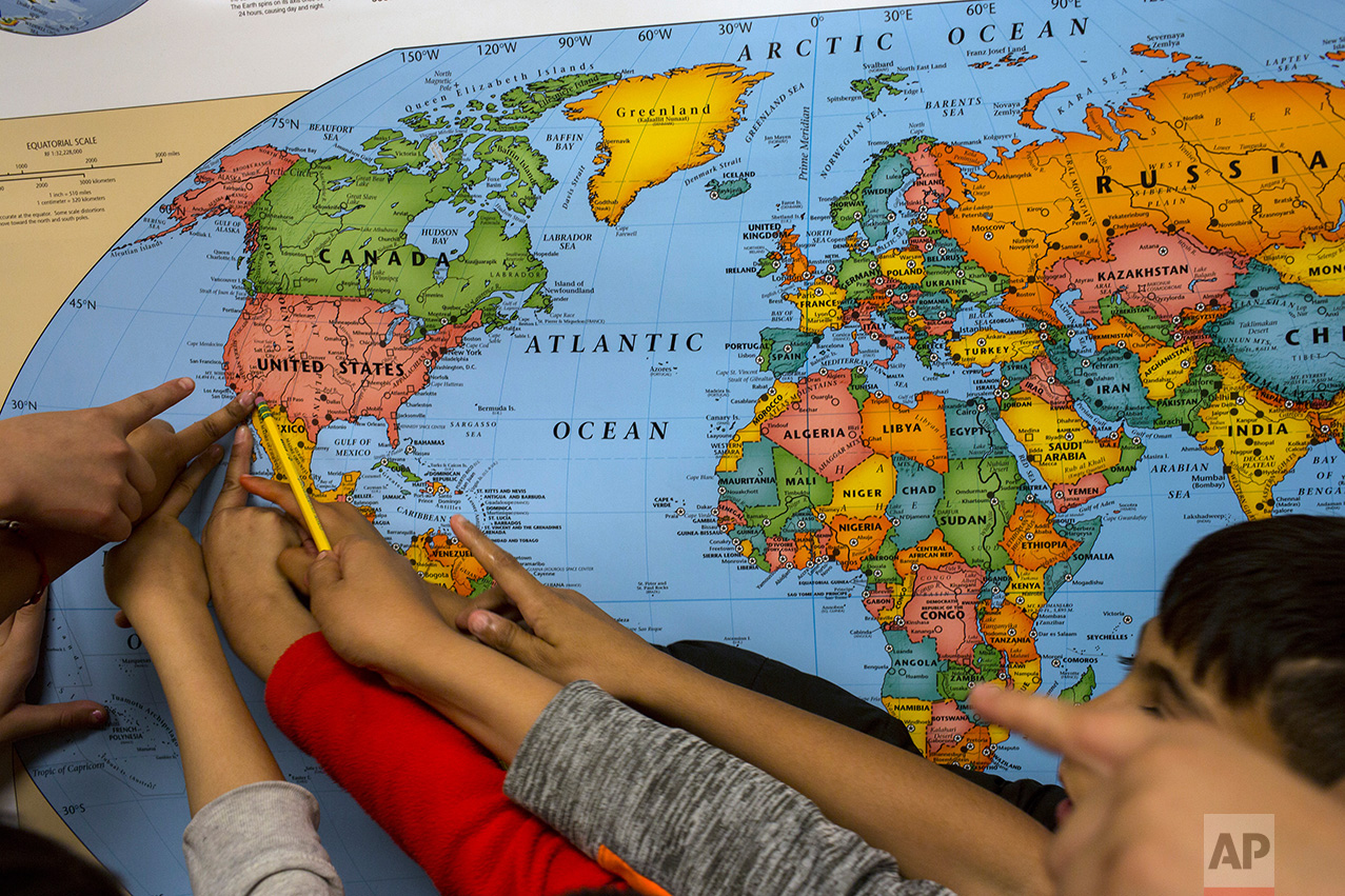 Fourth graders point out where they live on a map during a geography lesson class at the Columbus Elementary School, in Columbus, New Mexico, Friday, March 31, 2017. (AP Photo/Rodrigo Abd)
