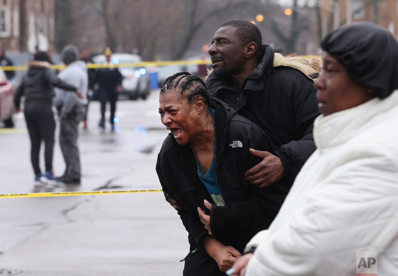 Georgia Jackson, 72, is overcome with emotion after learning that her two grandsons, Raheem, 19, and Dillon Jackson, 20, were found fatally shot in the South Shore neighborhood in Chicago on Thursday, March 30, 2017. Chicago police said Thursday several people were found fatally shot Thursday in or near a restaurant. Georgia Jackson said the two had gone to the restaurant to get food and to see their mother, who works there. (Chris Sweda/Chicago Tribune via AP)