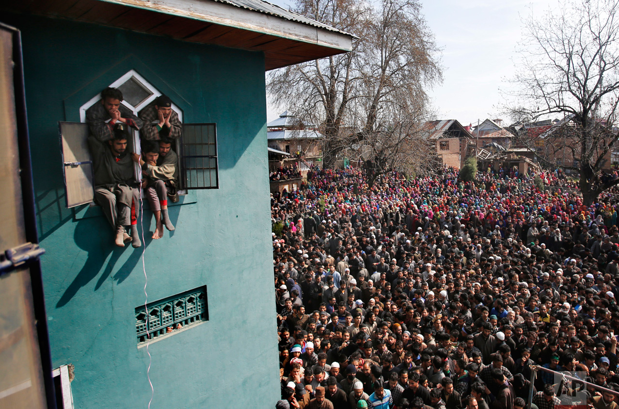 Villagers attend the funeral of a local suspected rebel commander Tauseef Ahmed Wagay at Yaripora, about 60 kilometers (37 miles) south of Srinagar in Indian-controlled Kashmir, Wednesday, March 29, 2017. Wagay was killed in a gunbattle with government forces in Kashmir. Three civilians were also killed and dozens injured in anti-India protests that erupted Tuesday following the gunbattle. (AP Photo/Mukhtar Khan)