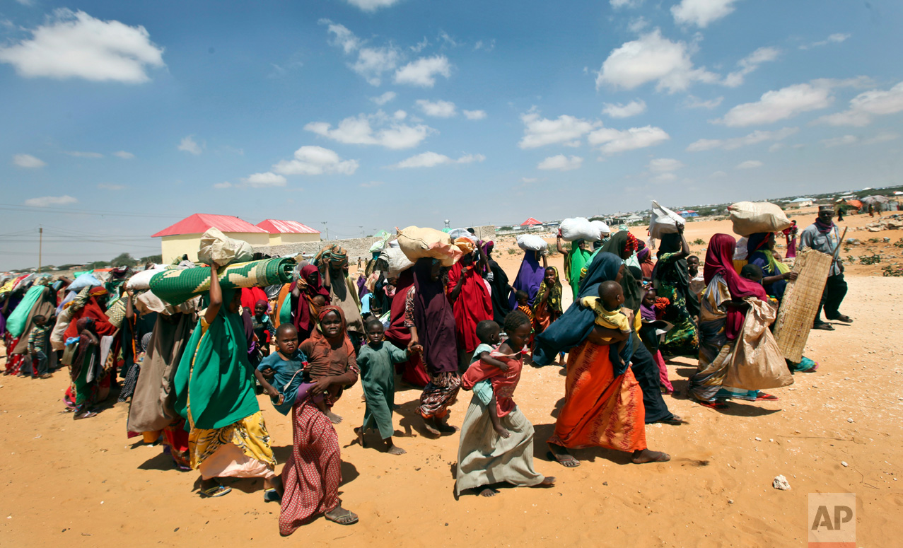 Families internally displaced by drought arrive at makeshift camps in the Tabelaha area on the outskirts of Mogadishu, Somalia, Thursday, March 30, 2017. Somalia's current drought is threatening half of the country's population, about 6 million people, according to the United Nations. Aid agencies have scaled up efforts but say more support is urgently needed. (AP Photo/Farah Abdi Warsameh)