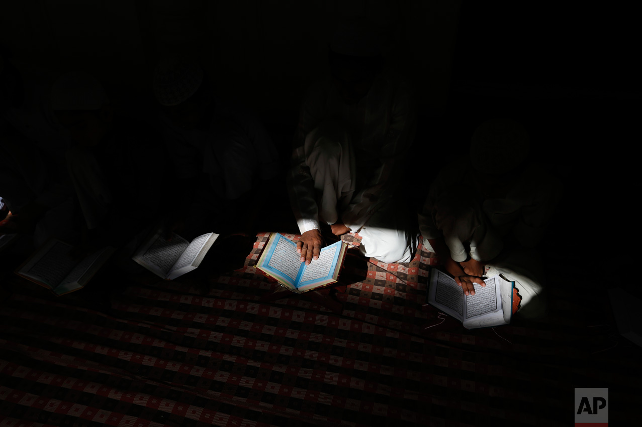 Indian Muslim children read the holy Quran at a mosque in Allahabad, Uttar Pradesh state, India, Tuesday, March 28, 2017. Uttar Pradesh, with a population of 204 million, is India's most populous state. (AP Photo/Rajesh Kumar Singh)