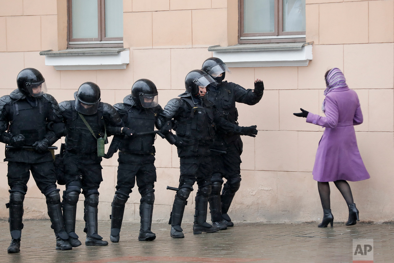 A woman argues with Belarus police officers blocking a street during an opposition rally in Minsk, Belarus, Saturday, March 25, 2017. Hundreds of people were arrested over the weekend after unsanctioned protests against authoritarian President Alexander Lukashenko in the capital. The protests followed sporadic demonstrations across the country over the past two months, an unusually persistent show of defiance in the former Soviet republic. (AP Photo/Sergei Grits)