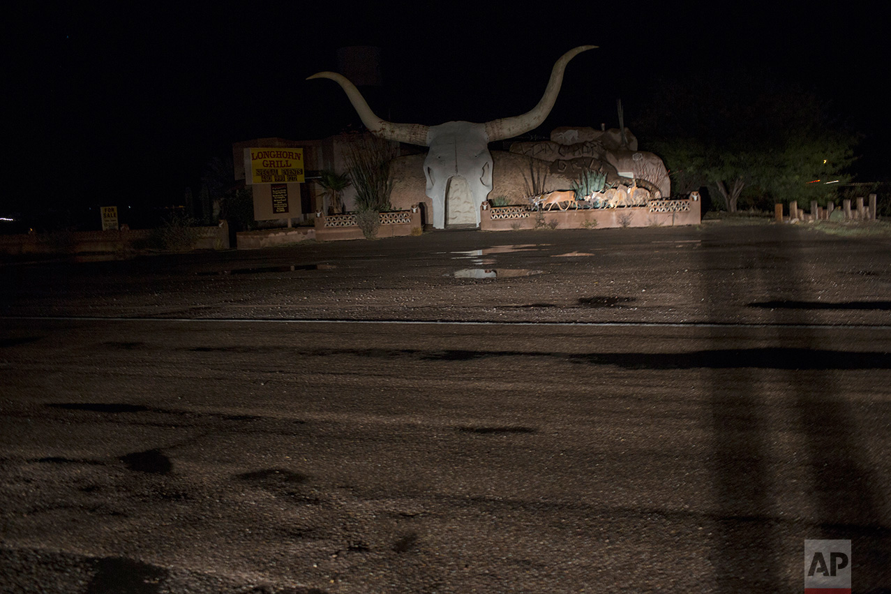 A giant longhorn skull sculpture serves as the entrance to the Longhorn Grill restaurant in Amado, Arizona, near the US-Mexico border, Saturday, April 1, 2017. (AP Photo/Rodrigo Abd)