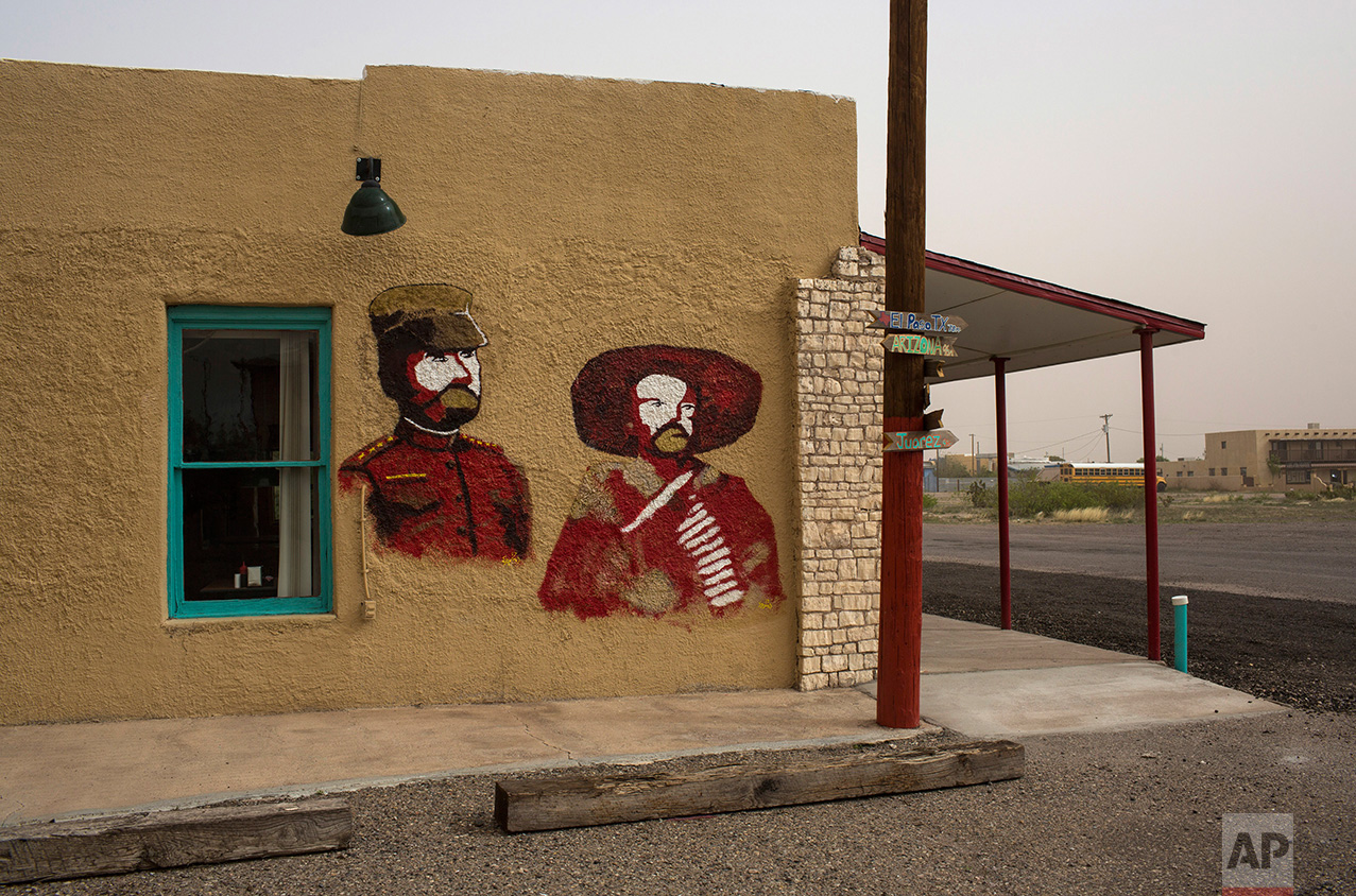 A mural depicts Mexican bandit and guerrilla leader in the Mexican Revolution Pancho Villa, right, and U.S Gen. John J. Pershing, side by side, on the wall of a cafe in Columbus, New Mexico, Friday, March 31, 2017. (AP Photo/Rodrigo Abd)