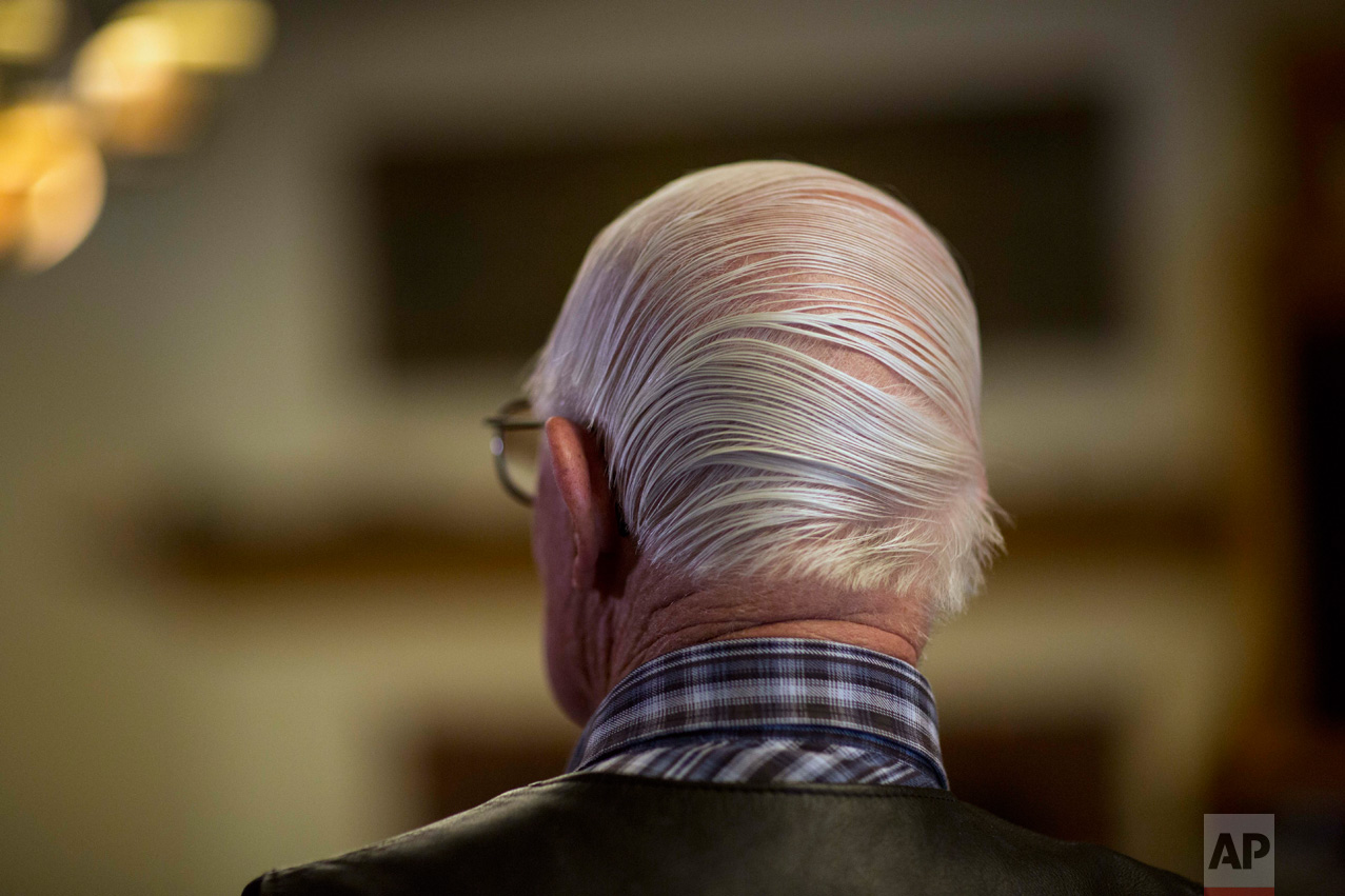 Rancher Jim Chilton shows off a combover hairstyle after removing his hat in his 50,000-acre ranch along the US-Mexico border in Arivaca, Ariz., Sunday, April 2, 2017. (AP Photo/Rodrigo Abd)