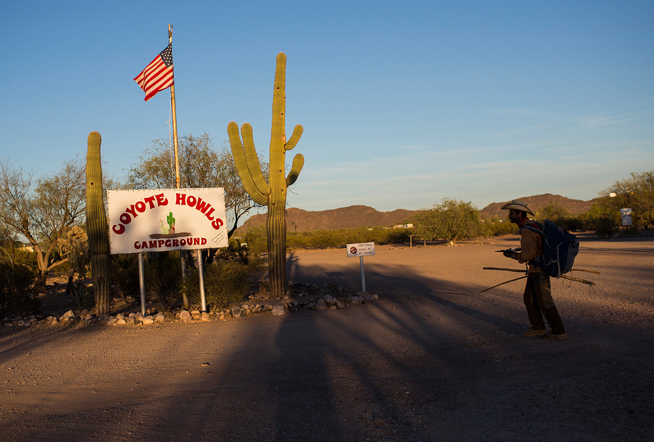 Mark Hainds, who is traveling the length of the U.S.-Mexico border by foot, arrives at the Coyote Howls RV park near Why, Arizona, Monday, April 3, 2017. (AP Photo/Rodrigo Abd)