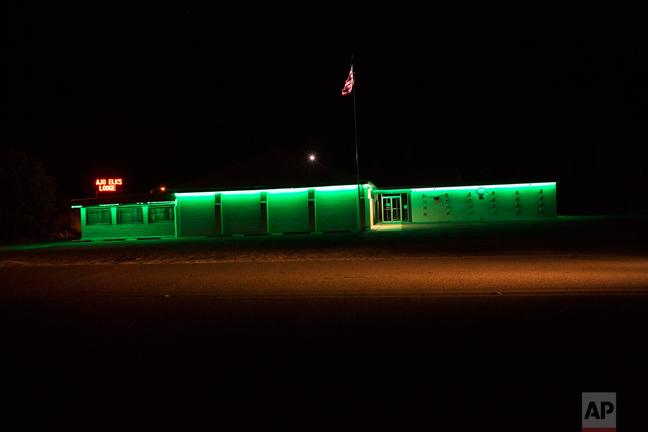 The Elks Lodge is illuminated in Ajo, Arizona, Monday night, April 3, 2017. (AP Photo/Rodrigo Abd)