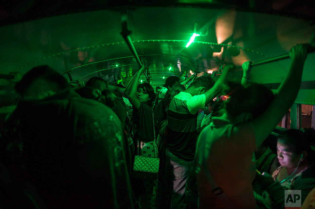 "In this Wednesday, March, 22, 2017 photo, people stand in a bus as they wait to go home after their work day at a ""maquiladora"" in Matamoros, Mexico, across the border from Brownsville, Texas. (AP Photo/Rodrigo Abd)"