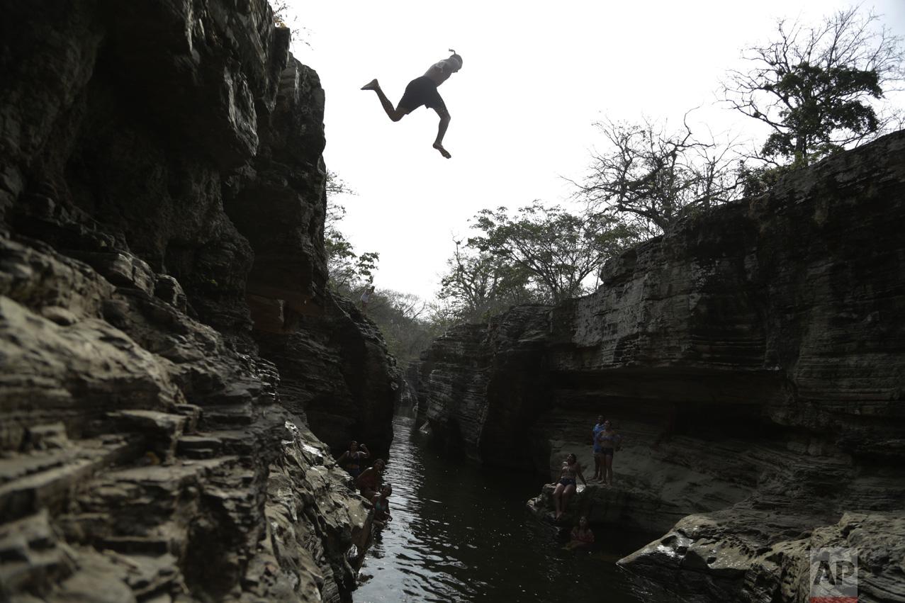 A man jumps into Los Cajones river in Chame, Panama, on Thursday, April 6, 2017. (AP Photo/Arnulfo Franco)