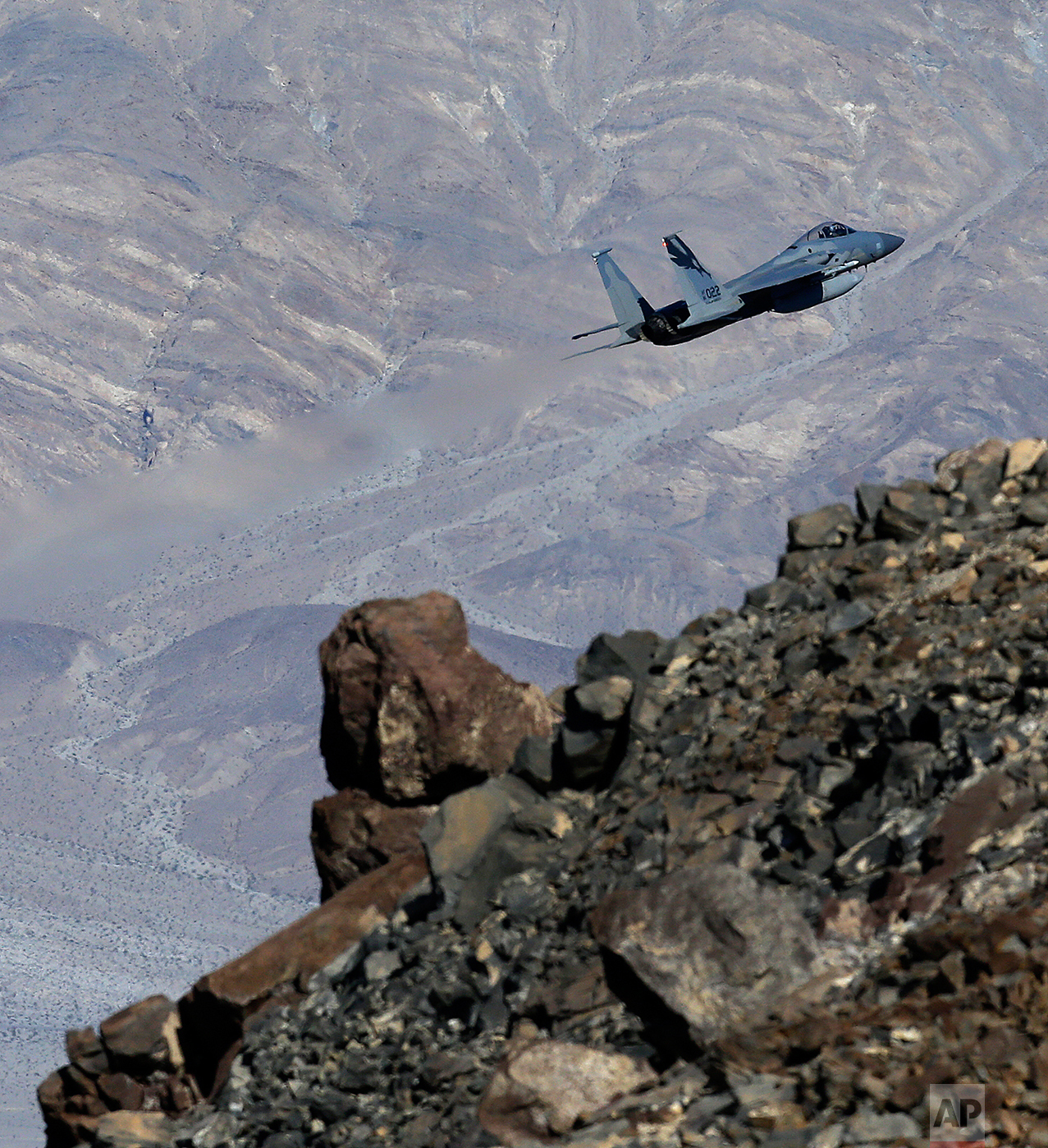 In this Feb. 28, 2017, photo, an F-15C Eagle from the California Air National Guard, 144th Fighter Wing, flies out of the nicknamed Star Wars Canyon over Death Valley National Park, Calif. (AP Photo/Ben Margot)