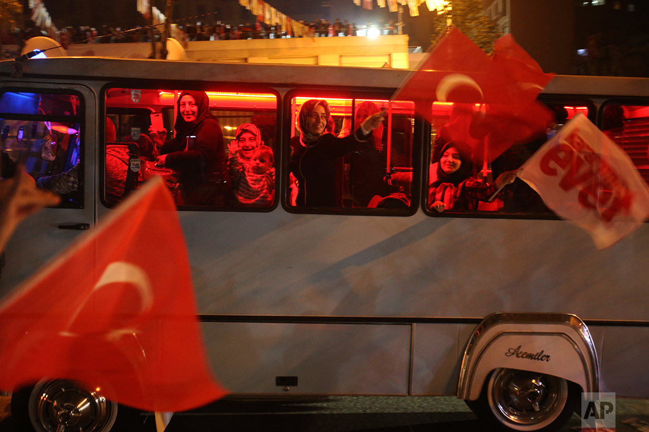 """Supporters of the """"Yes"""" vote, celebrate in Istanbul, on Sunday, April 16, 2017. With 97 percent of the ballots counted in Turkey's historic referendum, those who back constitutional changes greatly expanding President Recep Tayyip Erdogan's powers had a narrow lead Sunday night, the official Anadolu news agency said. (AP Photo/Petros Karadjias)"""