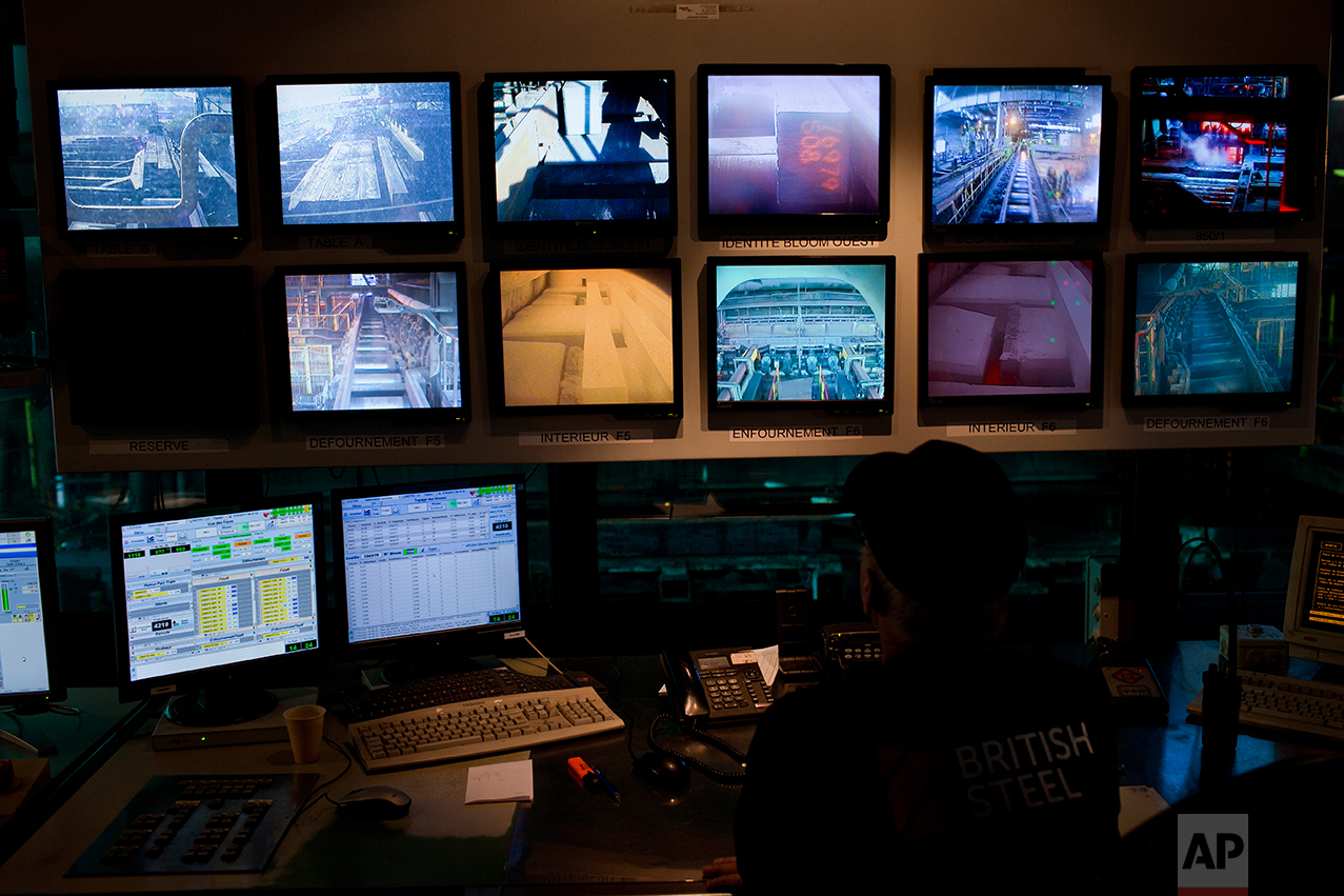 "Monitors as a worker controls the production inside the ""British Steel"" factory. (AP Photo/Emilio Morenatti)"