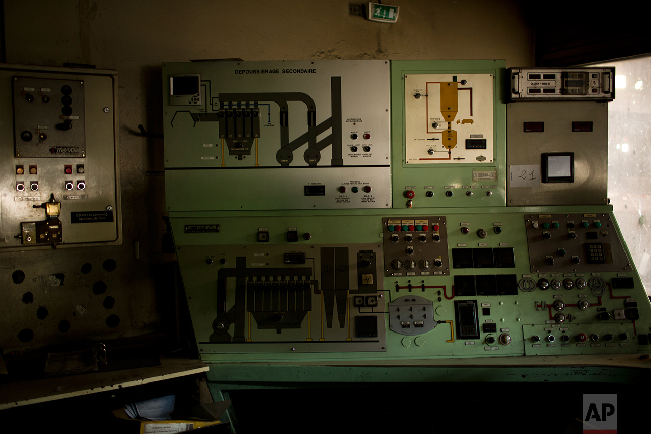 This Tuesday April 4, 2017 photo shows the main control panel of a former steel factory abandoned inside an industrial unit at Hayange, a commune in the Moselle department in Grand East in north-eastern France. (AP Photo/Emilio Morenatti)