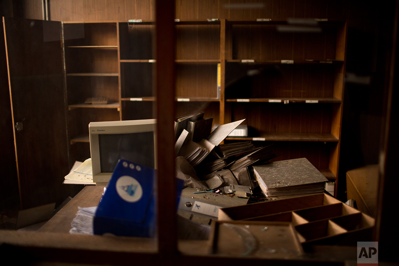 This Monday April 3, 2017 photo shows the office of a former factory inside an abandoned industrial unit at Hayange, a commune in the Moselle department in Grand Est in north-eastern France.  (AP Photo/Emilio Morenatti)
