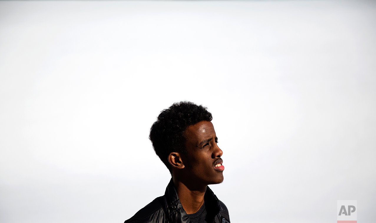 """Abdiaziz Shaleh, 19, a Lewiston high school senior and co-captain of the soccer team poses for a portrait against the snow in Lewiston, Maine, Wednesday, March 15, 2017. Shaleh, whose family is from Somalia, waited with them for several years in a refugee camp in Kenya before coming to the United States and eventually settling in Lewiston. Shaleh said President Trump's election has created fear in the refugee community, including among the many students who come from immigrant families. Shaleh also worries about the many refugees who are suffering in Somalia and other parts of Africa, where famine remains a huge issue. """"We got that chance (to come to America),"""" he said. """"I just wanted them to have the same chance."""" (AP Photo/David Goldman)"""