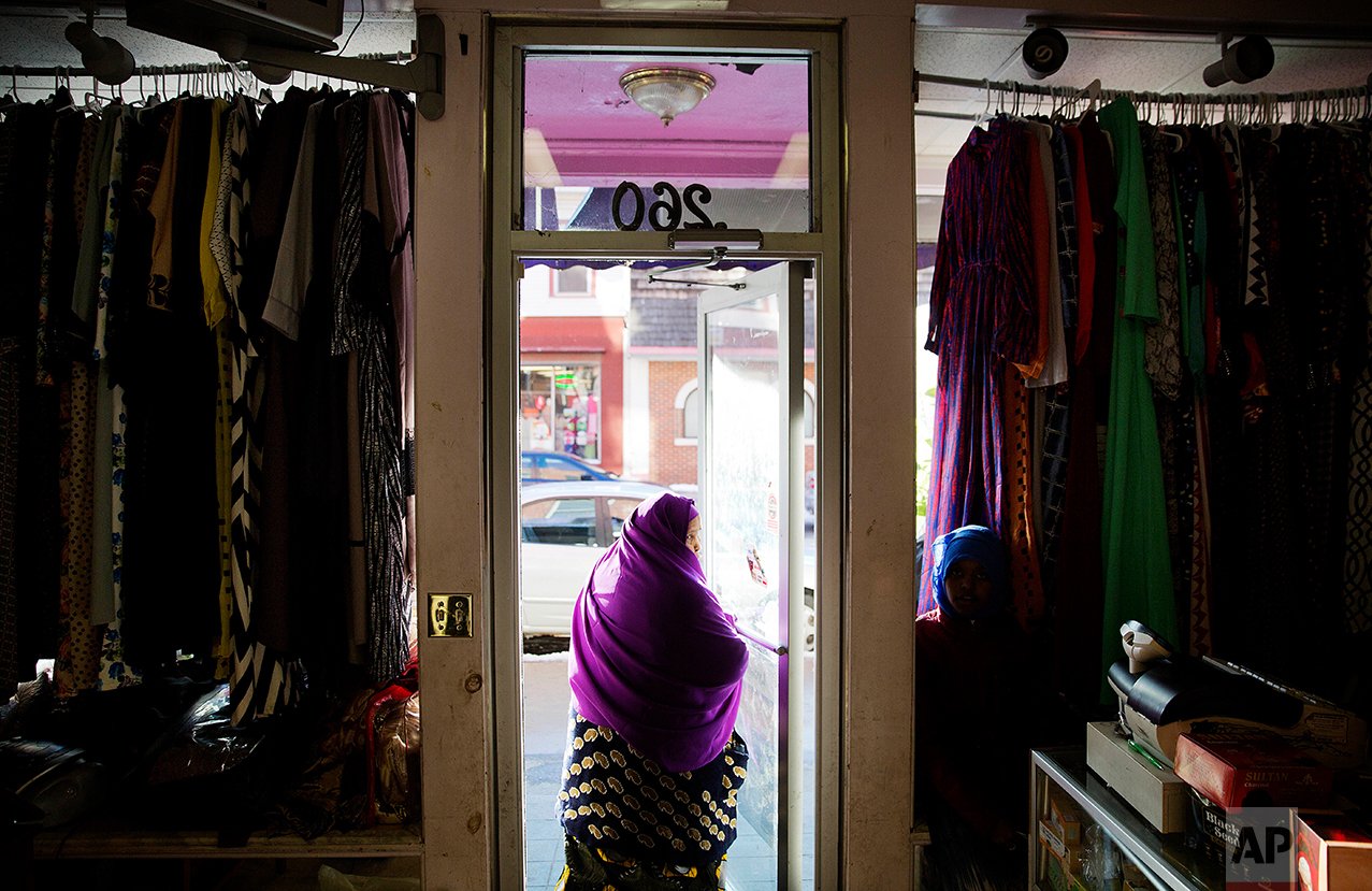 A woman wearing a khimar leaves after shopping at one of the many stores owned by Somali immigrants who have settled in Lewiston, Maine.(AP Photo/David Goldman)