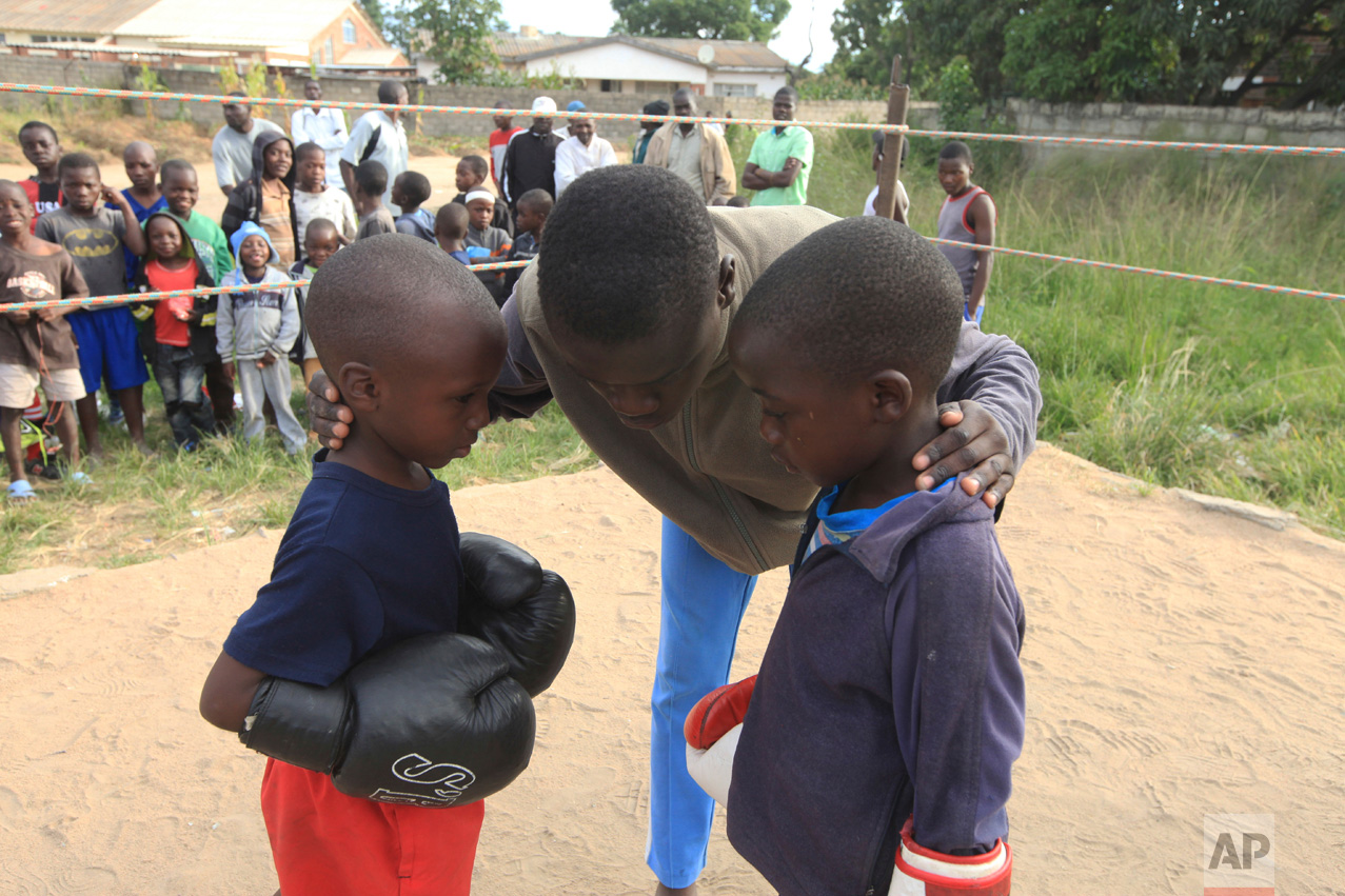 In this Sunday, March 11, 2017 photo, a referee gives children instructions before they fight, in a boxing ring in Chitungwiza. (AP Photo/Tsvangirayi Mukwazhi)