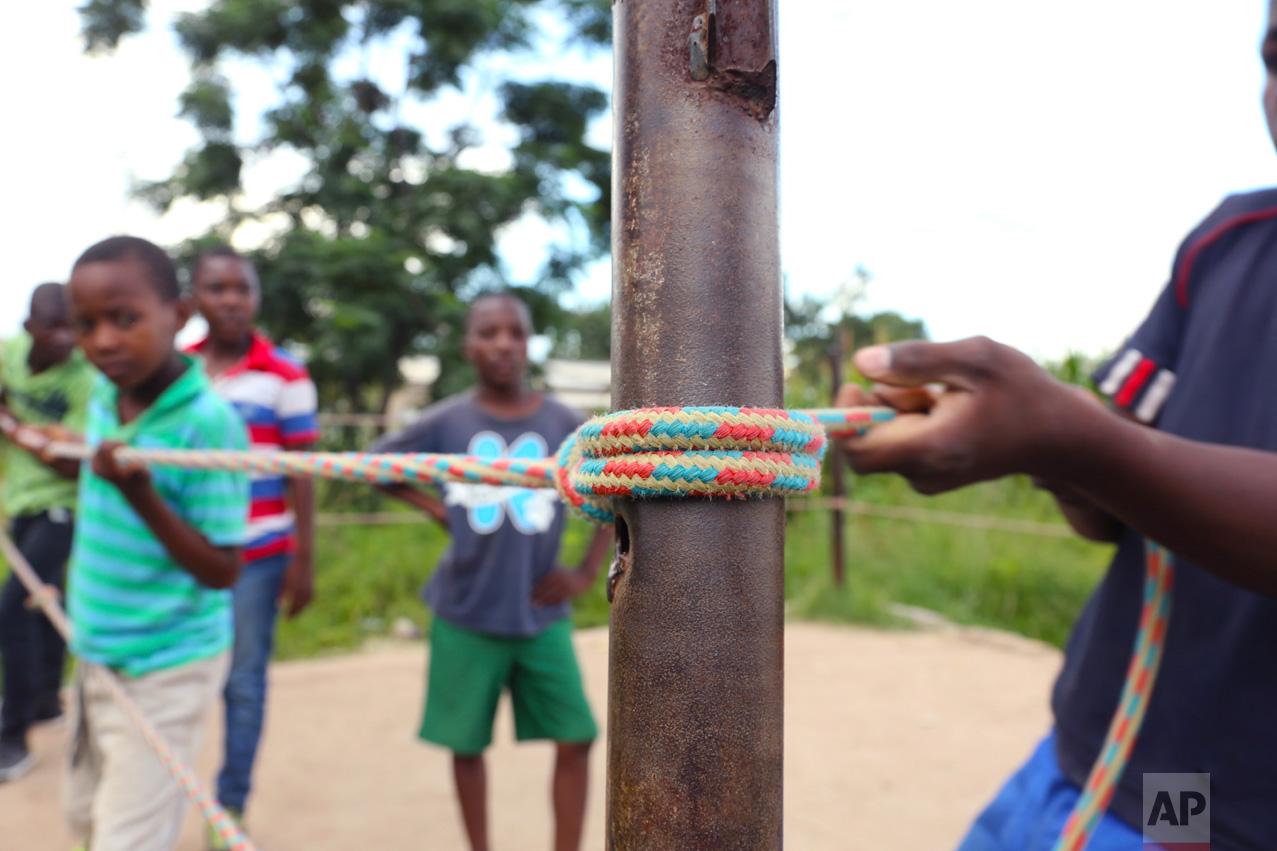 In this Saturday, Feb. 12, 2017 photo, children prepare a boxing ring in Chitungwiza, ZImbabwe. (AP Photo/Tsvangirayi Mukwazhi)