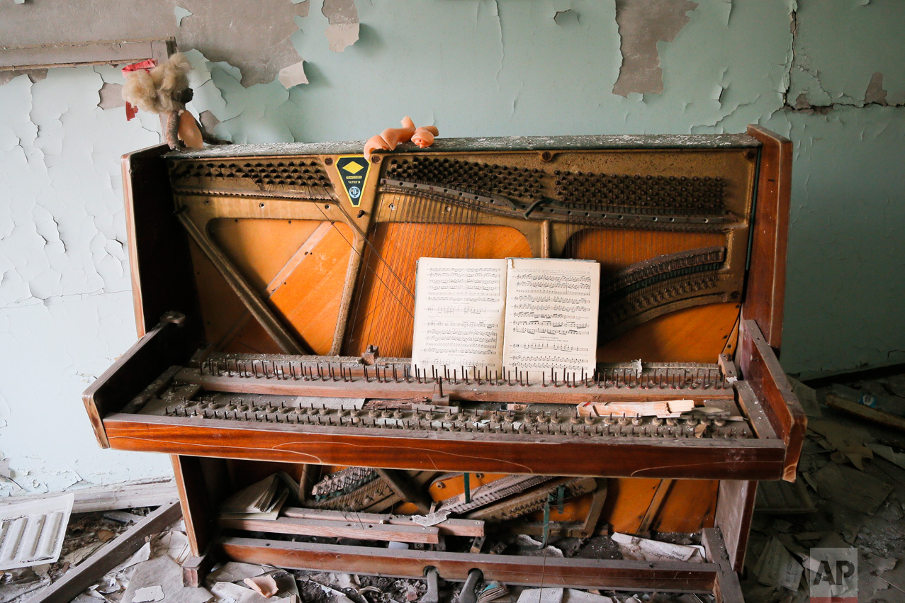 In this photo taken Wednesday, April 5, 2017, a decrepit piano stands in a school in the deserted town of Pripyat, some 3 kilometers (1.86 miles) from the Chernobyl nuclear power plant Ukraine. (AP Photo/Efrem Lukatsky)