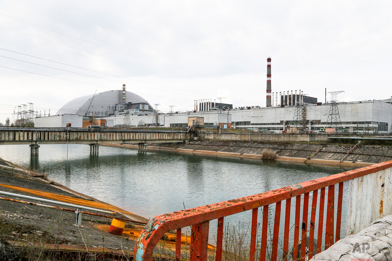 In this photo taken Wednesday, April 5, 2017, a new shelter is installed over the exploded reactor at the Chernobyl nuclear plant, in Chernobyl, Ukraine. (AP Photo/Efrem Lukatsky)