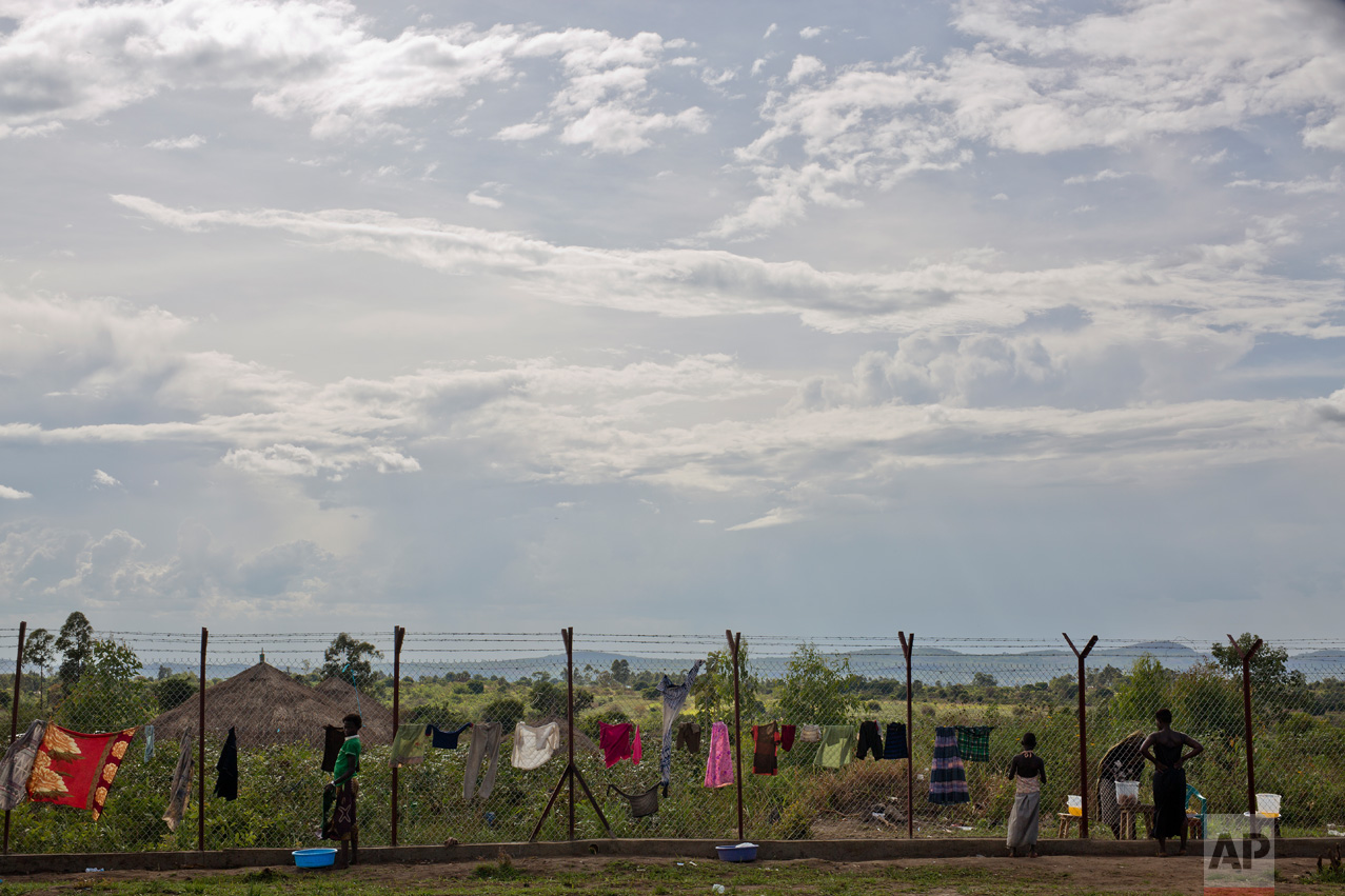 In this Wednesday March 29, 2017 photo, laundry is set to dry on the perimeter fence surrounding the Imvepi refugee settlement processing center in northern Uganda. There were high hopes that South Sudan would have peace and stability after its independence from neighboring Sudan in 2011. But the country plunged into ethnic violence in December 2013 when forces loyal to President Salva Kiir, a Dinka, started battling those loyal to Riek Machar, his former vice president who is a Nuer. (AP Photo/Jerome Delay)