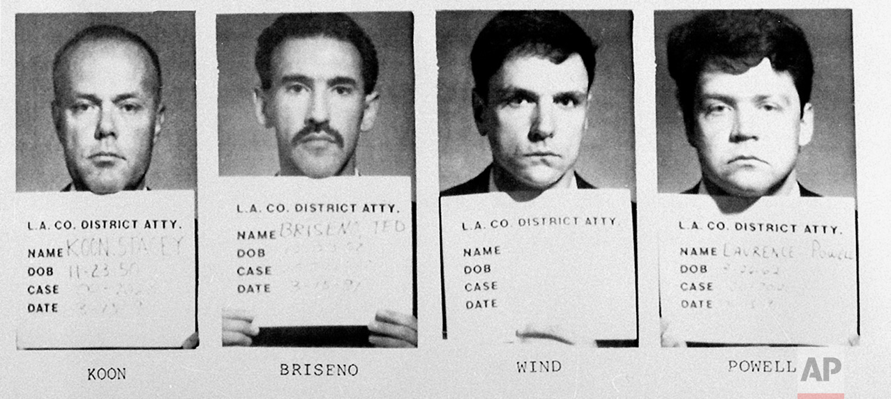 Stacey Koon and officers Theodore Briseno, Laurence Powell and Timothy Wind are shown, March 14, 1991. (AP Photo/LA District Attorney)
