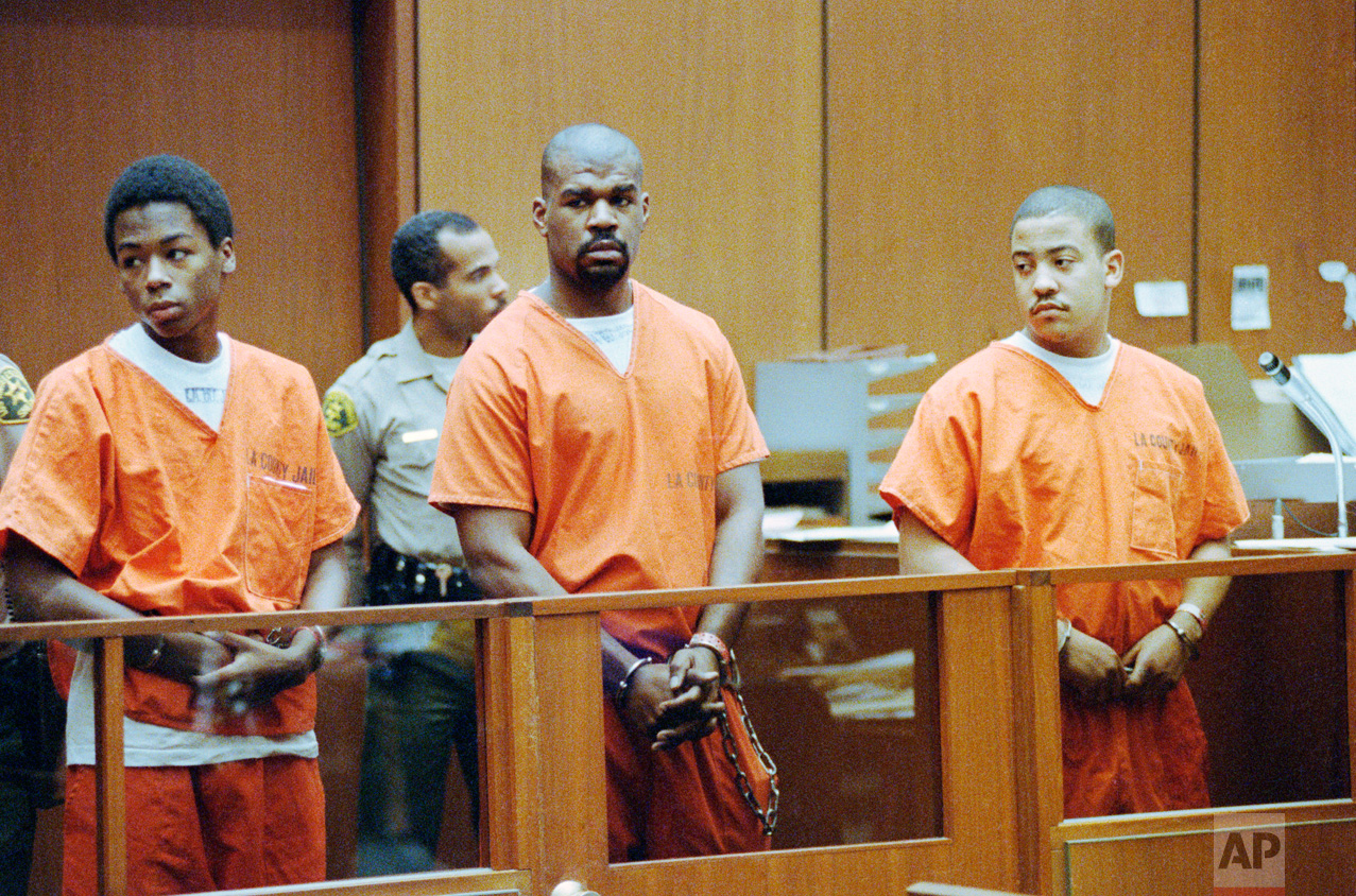 Antoine Miller, Henry Watson and Damian Williams, left to right, stand in Superior Court in Los Angeles, Aug. 25, 1992 for arraignment on charges in connection with the riot-related beating of trucker Reginald Denny. The case was assigned to a black judge who was immediately removed by the prosecution, raising defense claims of racism. (AP Photo/Nick Ut)
