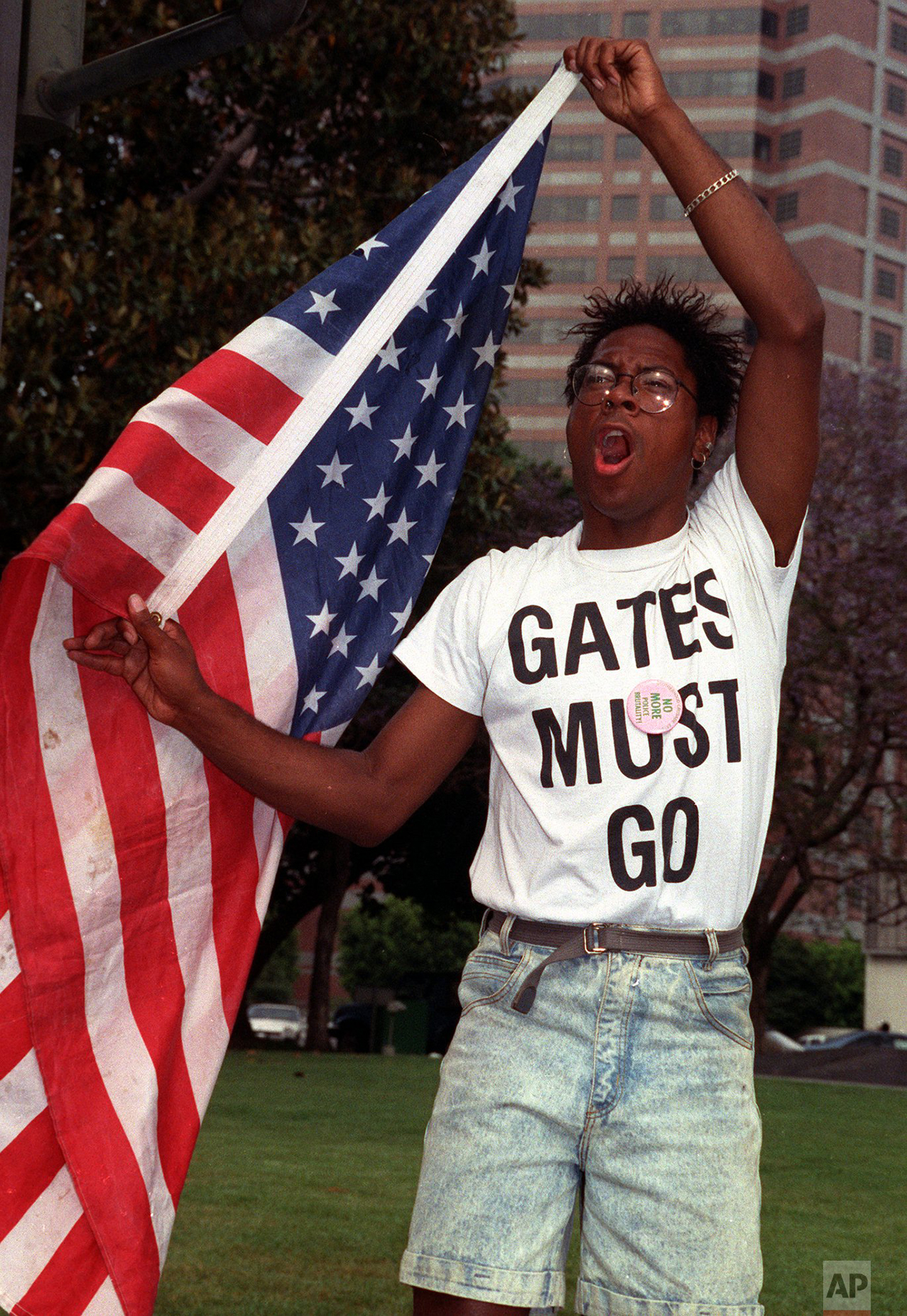 An unidentified protester voices his opposition to the acquittal of the four Los Angeles Police officers on all charges but one Wednesday, April 29, 1992 outside Parker Center in Los Angeles. (AP Photo/Chris Martinez)