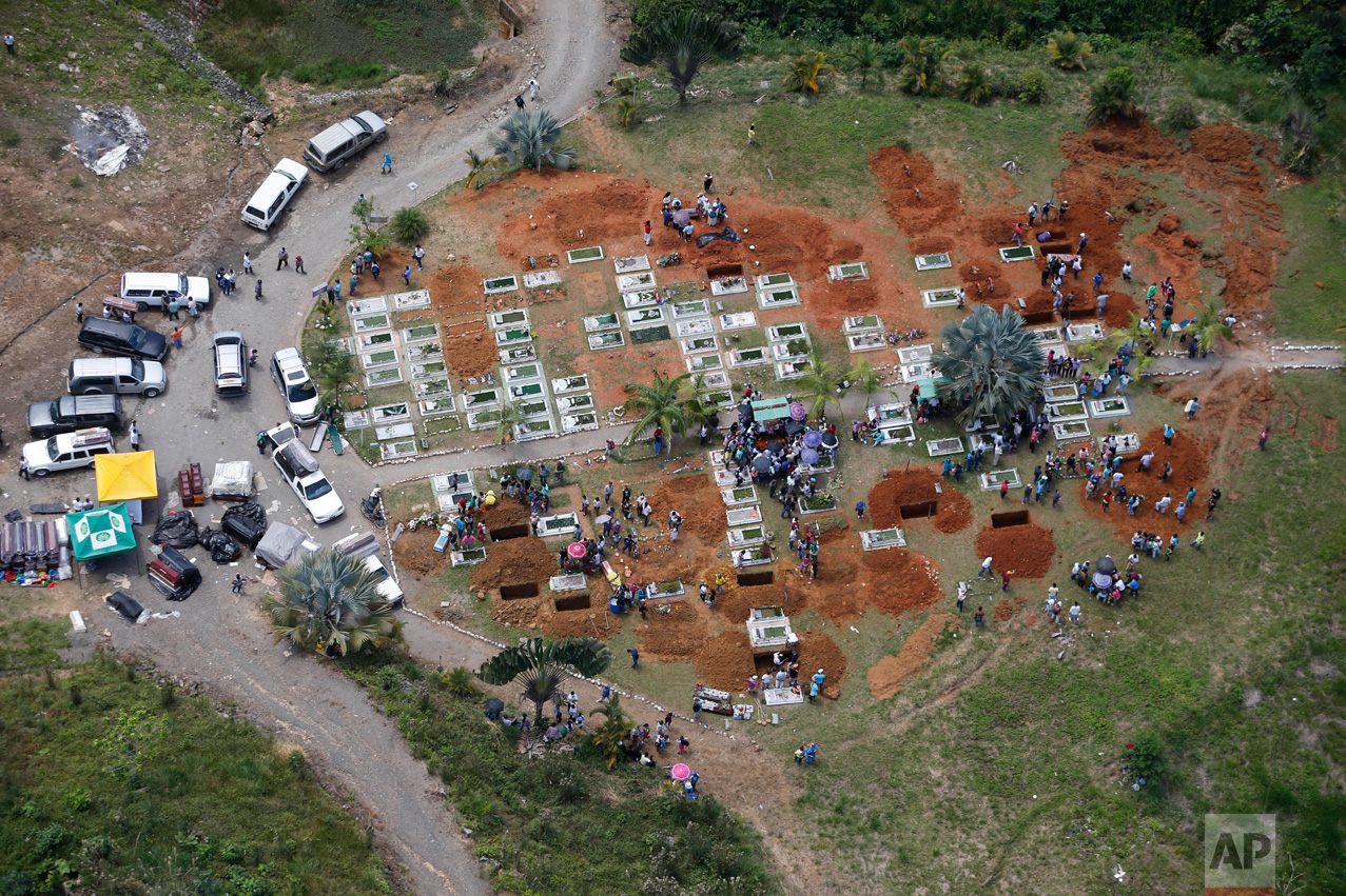 Dozens of freshly dug graves are seen from the air in Mocoa, Colombia, Tuesday, April 4, 2017. Colombian authorities said at least 273 people were killed when rivers surrounding Mocoa overflowed and sent a wall of water and debris surging through the city over the weekend. The death toll was expected to rise since many more were missing and bodies are still being found. (AP Photo/Fernando Vergara)