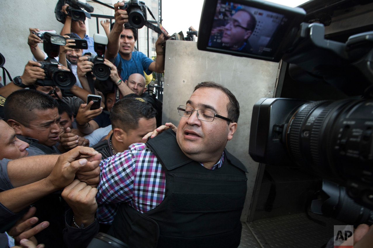 Mexico's former Veracruz state Gov. Javier Duarte boards a police van after attending a hearing in Guatemala City, Wednesday, April 19, 2017. Duarte wanted on corruption charges is appearing before a Guatemalan court that will consider his possible extradition. (AP Photo/Moises Castillo)