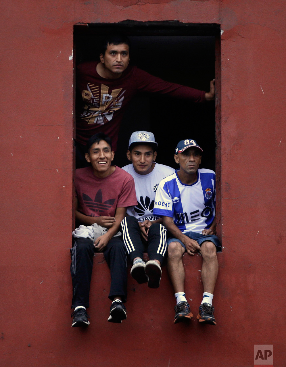 In this Monday, May 1, 2017 photo, soccer fans watch from an apartment balcony, which they rented for about $2 dollars, as their teams compete at the Little World Cup Porvenir street soccer championship in Lima, Peru. The annual ritual is Peru's most famous futsal. (AP Photo/Martin Mejia)