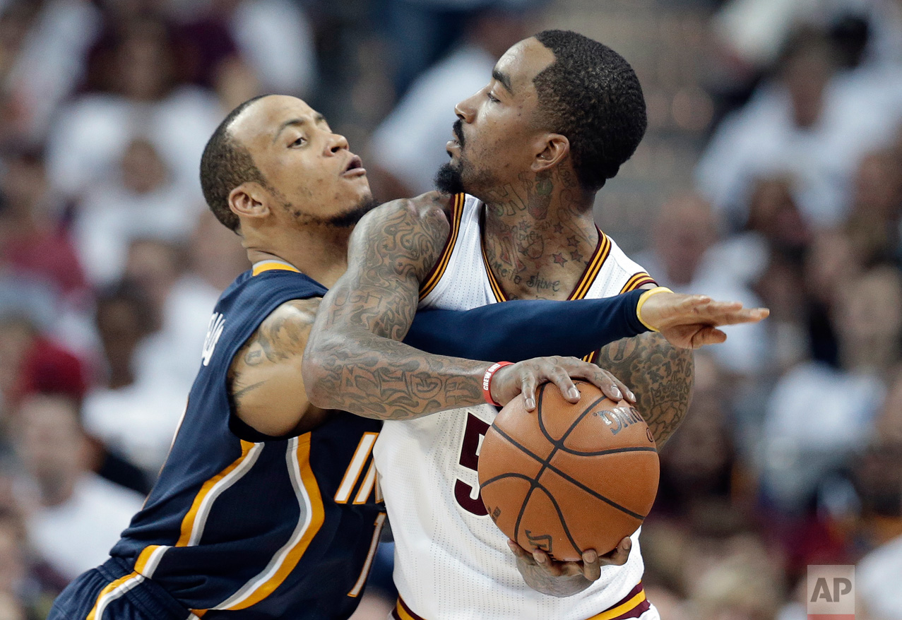 Indiana Pacers' Monta Ellis, left, puts pressure on Cleveland Cavaliers' J.R. Smith during the second half in Game 1 of a first-round NBA basketball playoff series, Saturday, April 15, 2017, in Cleveland. The Cavaliers won 109-108. (AP Photo/Tony Dejak)